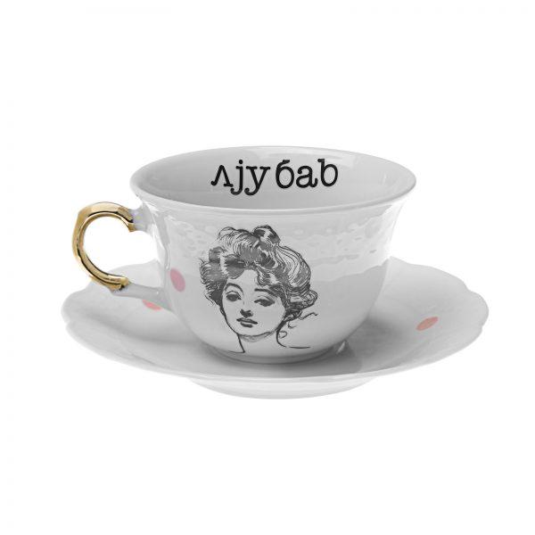white porcelain tea cup